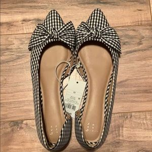 Never worn black and white flats with bow detail